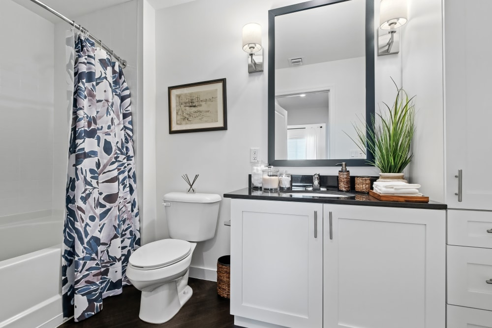 Model bathroom with plenty of storage at Town Lantana in Lantana, Florida