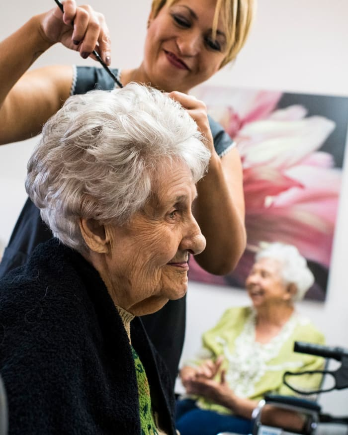Resident getting a hair cut at The Springs at Greer Gardens in Eugene, Oregon