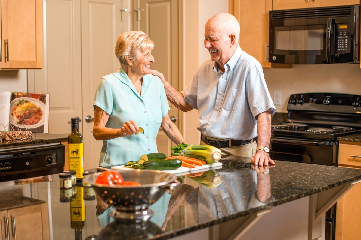 Couple making dinner at Watercrest at Bryan in Bryan, Texas