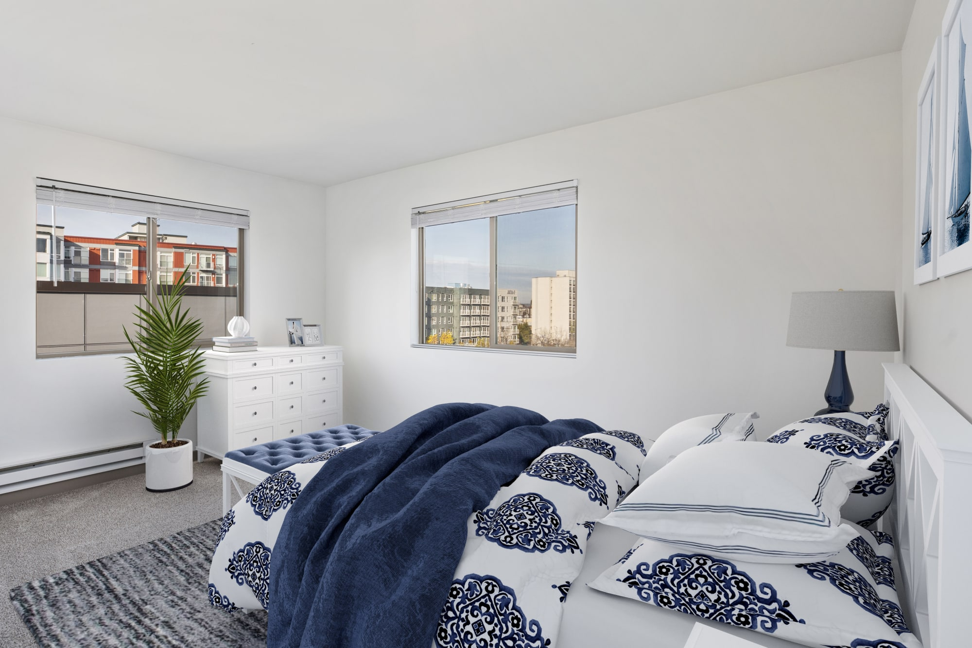 A bedroom with cityscape views at Elan 41 Apartments in Seattle, Washington