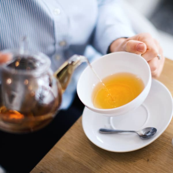 Pouring tea at Pacifica Senior Living Menifee in Sun City, California.