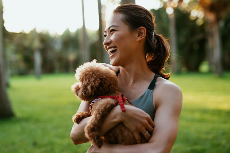 Resident and her dog enjoying their new life at Lumen Apartments in Everett, Washington