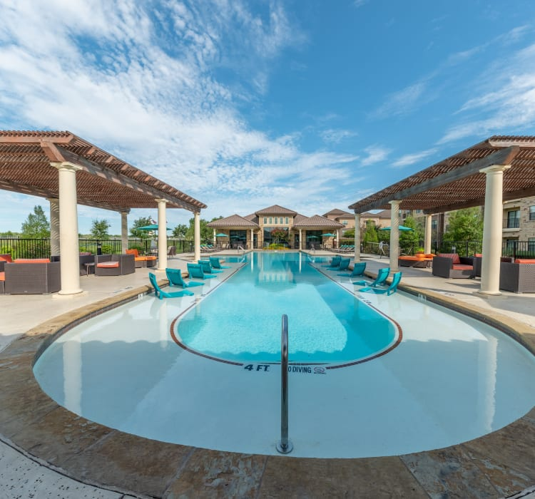 Bueatiful pool and cabanas at Evolv in Mansfield, Texas