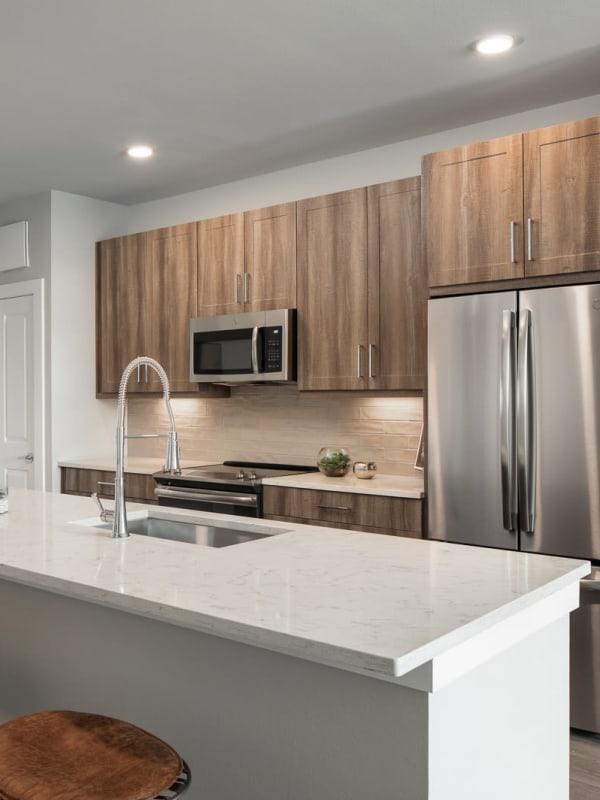Sleek, modern kitchen at Bellrock Market Station in Katy, Texas