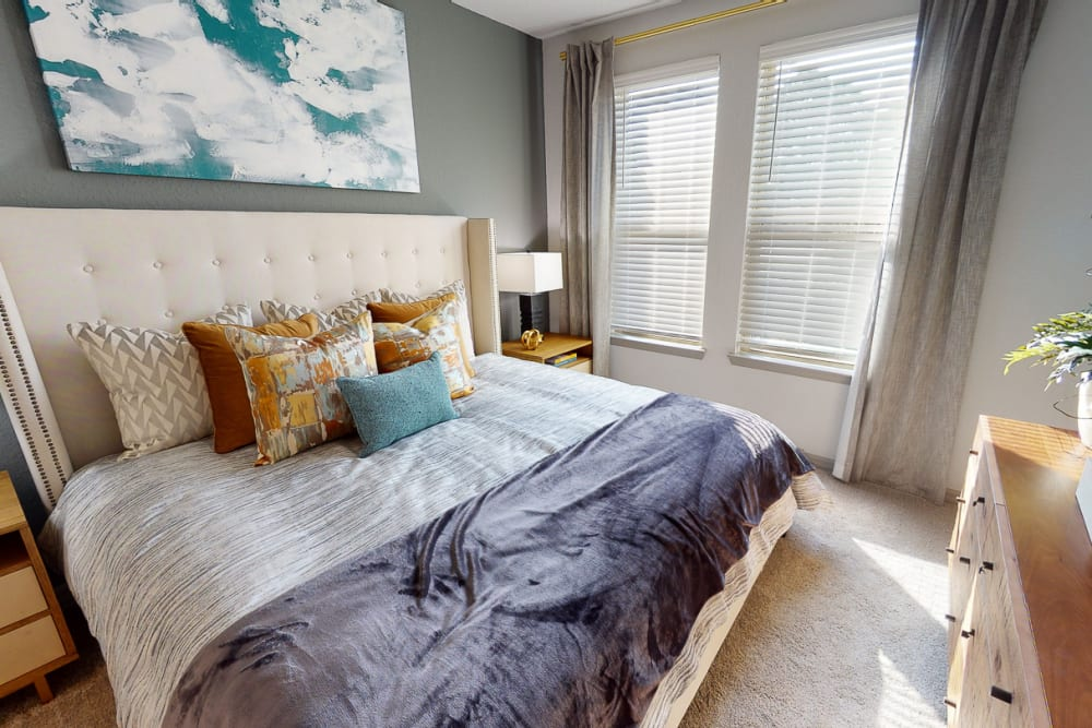 Model bedroom with large window at Integra 289 Exchange in DeBary, Florida