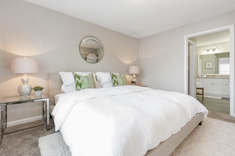 Master bedroom with lots of light and a private bathroom at Belle Vista Apartment Homes in Lithonia, Georgia