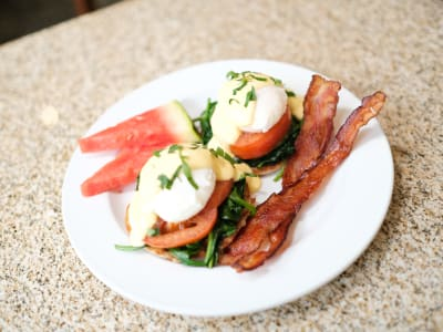Eggs Benedict served with a side of Watermelon and Bacon at The Terraces at Park Marino