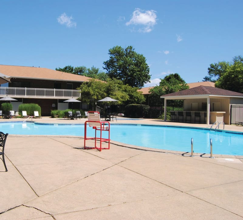 Resort-style swimming pool at Racquet Club Apartments and Townhomes in Levittown, Pennsylvania