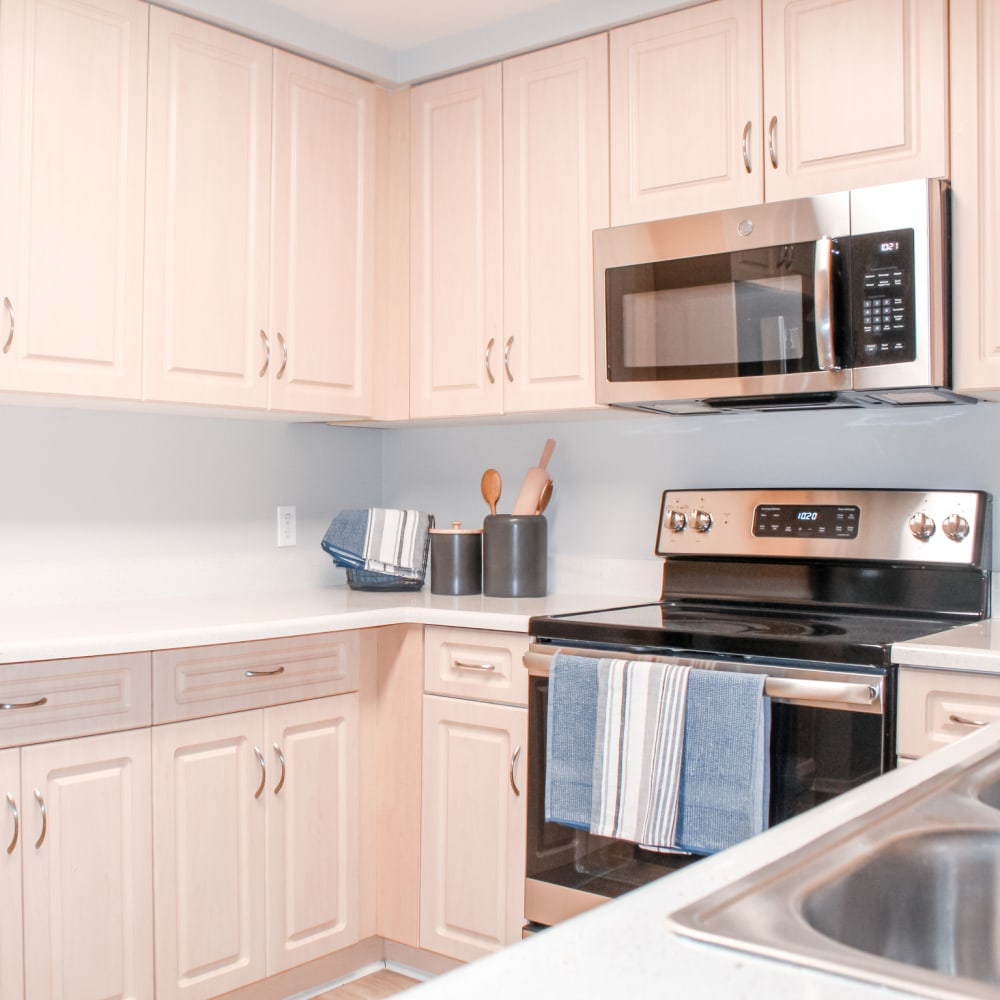 Model kitchen with updated appliances at K Street Flats Apartment Homes in Berkeley, California