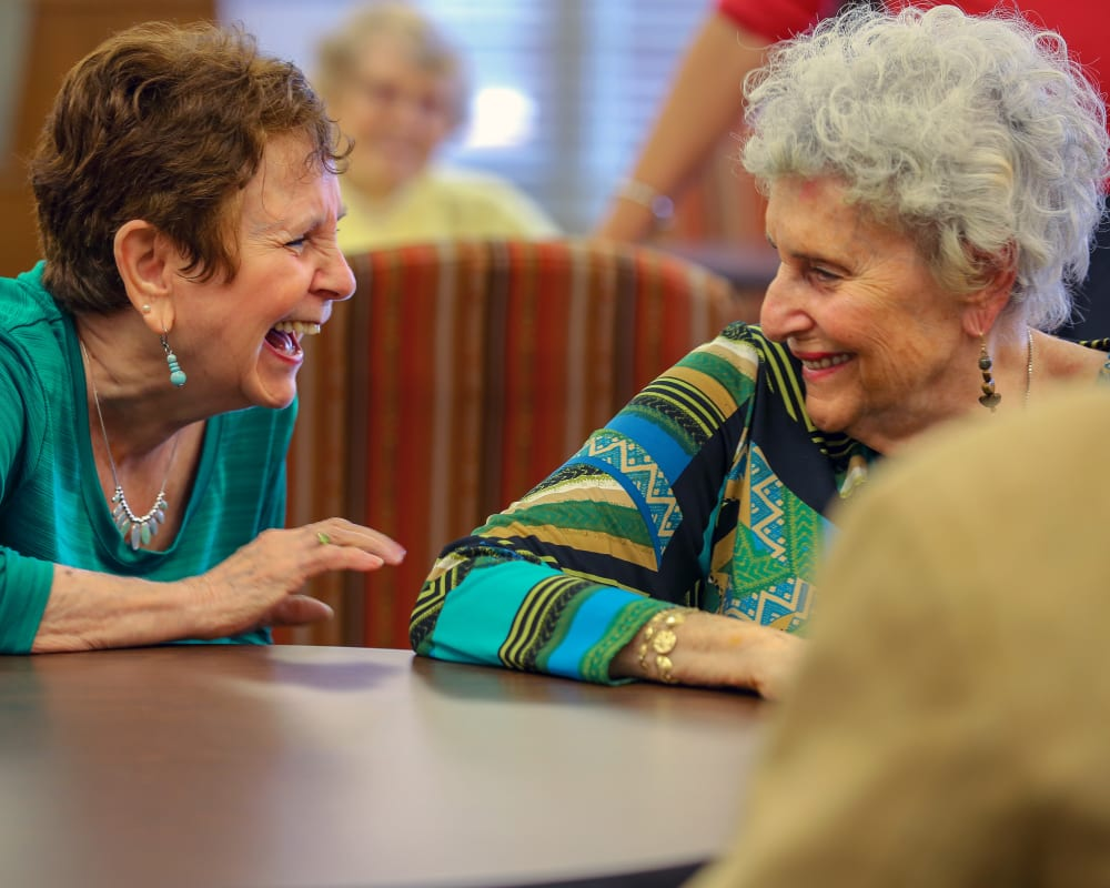 Residents laughing together at Harmony at Avon in Avon, Indiana