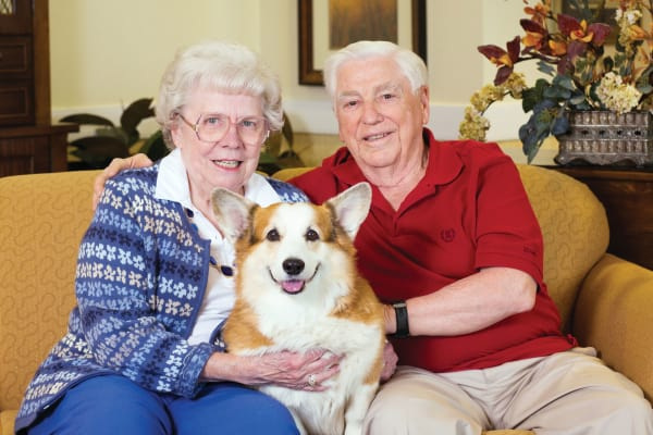 Senior couple holding a dog at Anson Senior Living in Zionsville, Indiana