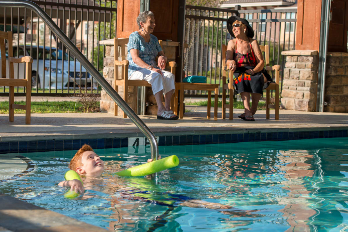 Resident's grandson swimming in the pool at Raider Ranch in Lubbock, Texas