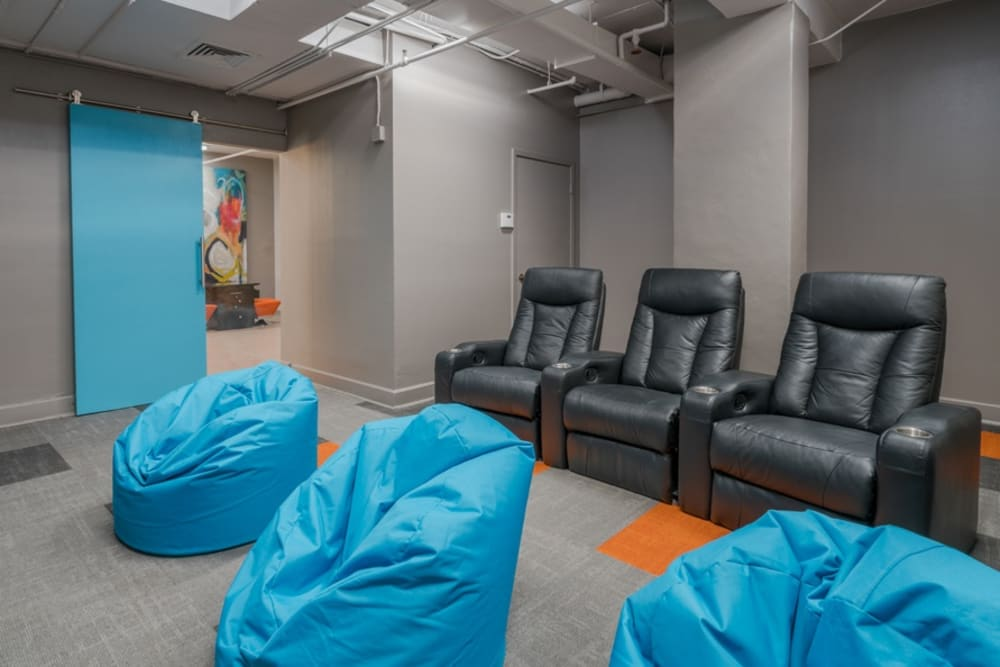 Comfortable theater seating at The Enclave at 1550 Apartments in San Antonio, Texas