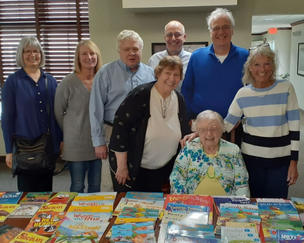 Resident Alice and family with books donated for her dare to dream event at Clover Ridge Place in Maquoketa, Iowa.