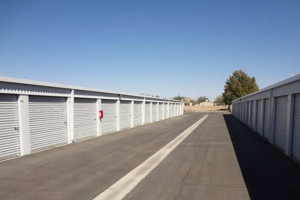 Outdoor drive-up storage units at A-American Self Storage in Ridgecrest, California