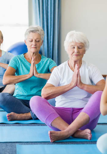 A resident in a wellness class at The Claiborne at Newnan Lakes in Newnan, Georgia
