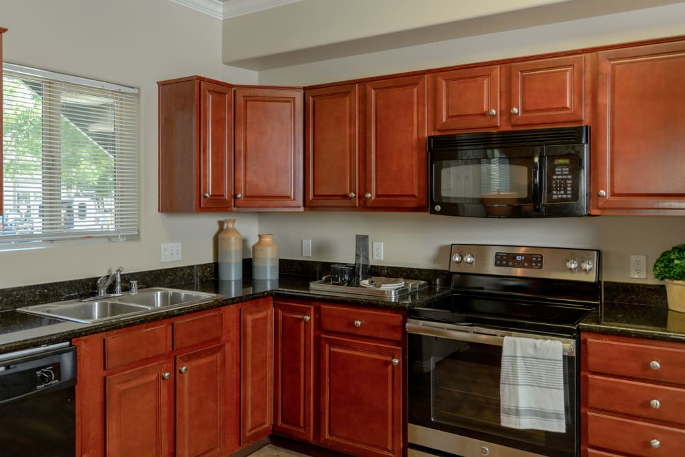 Beautiful, gourmet kitchen in a model home at Wolf Ranch Condominium Rentals in Sacramento, California