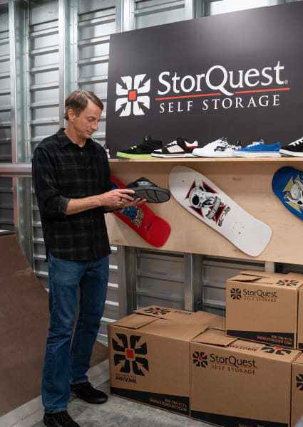Tony Hawk shows off some cool shoes at StorQuest Self Storage