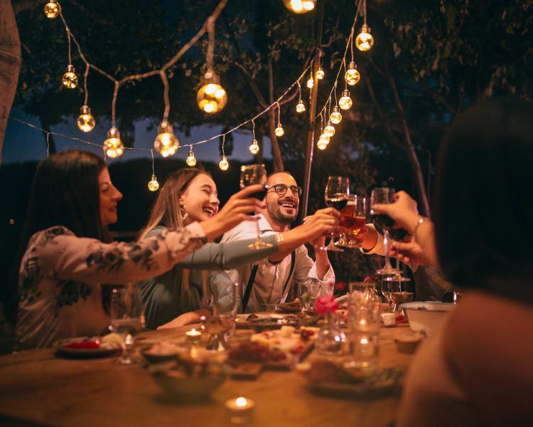 Friends enjoying dinner and wine in Hampton, New Hampshire near Olde Hampton Village Apartments