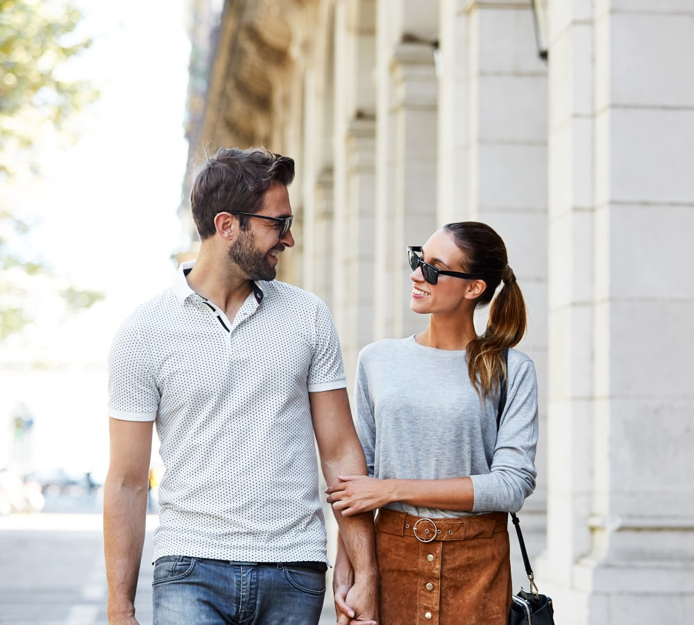 Resident couple walking around downtown near Sofi Ventura in Ventura, California