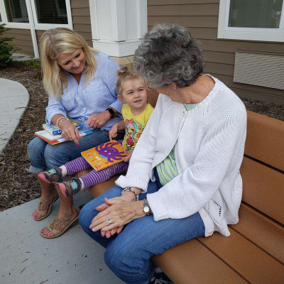 A resident interacts with a child at an intergenerational event near Arbor Glen Senior Living in Lake Elmo, Minnesota