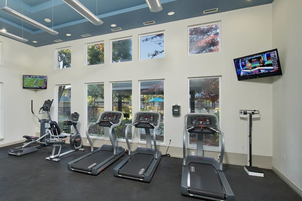 Fitness center with plenty of workout stations at Cortland Village Apartment Homes in Hillsboro, Oregon