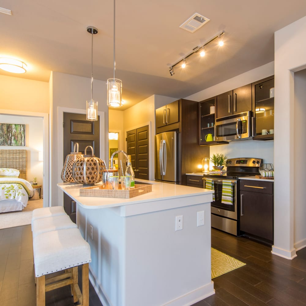 Kitchen with a spacious breakfast bar at Elite 99 West in Katy, Texas