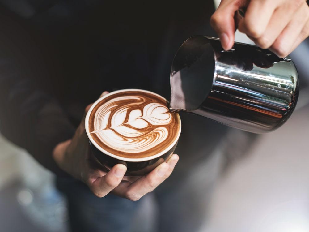 Barista making a latté for a customer near Haven Martinez in Martinez, California