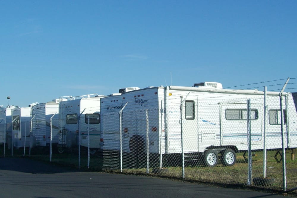 RVs parked behind a gate at U-Lock-It Self Storage in Vancouver, Washington