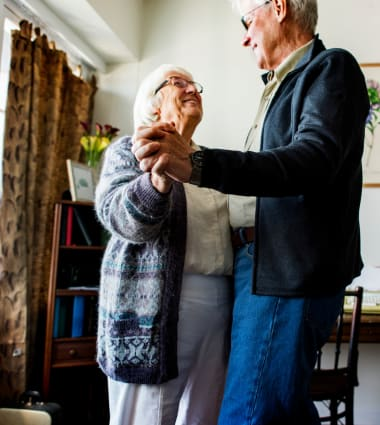 Two residents dancing at Mirror Lake Village Senior Living Community in Federal Way, Washington.