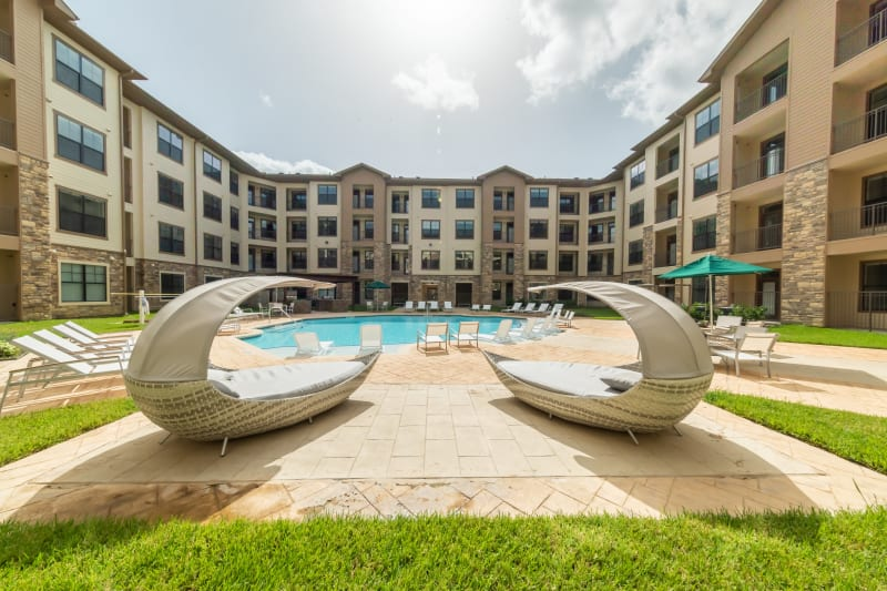 Lounge at our new resort-style pool at Haven at Liberty Hills in Houston, TX