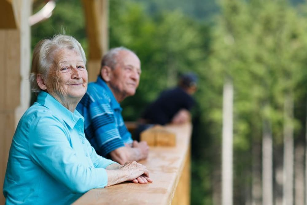 Residents enjoying the view happily outside of The Willows Retirement & Assisted Living in Blackfoot, Idaho