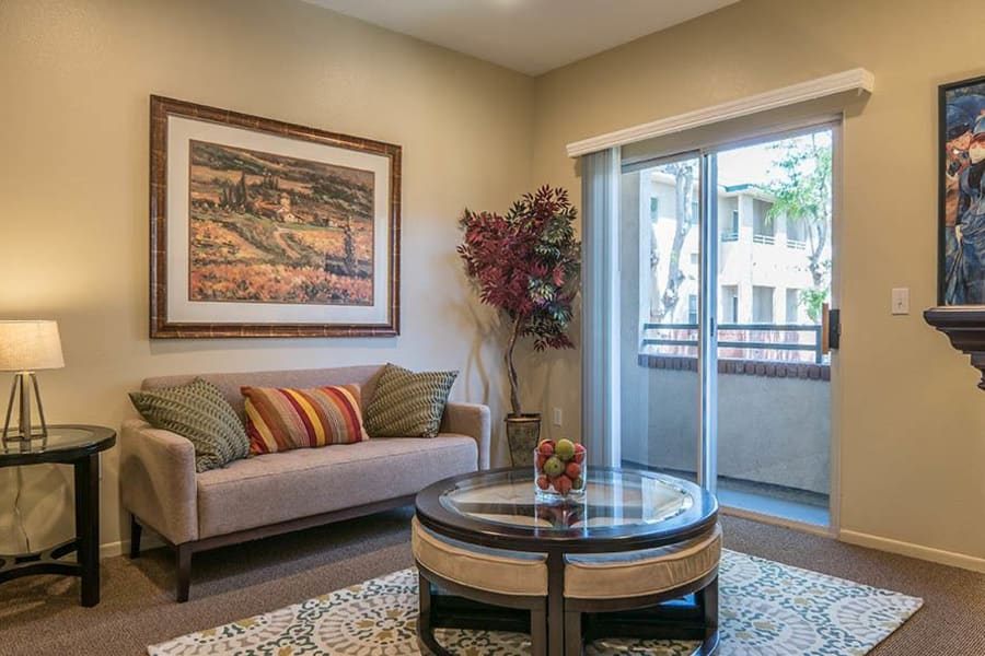 Well-decorated living area in one of our senior living suites at Carmel Village in Fountain Valley, California