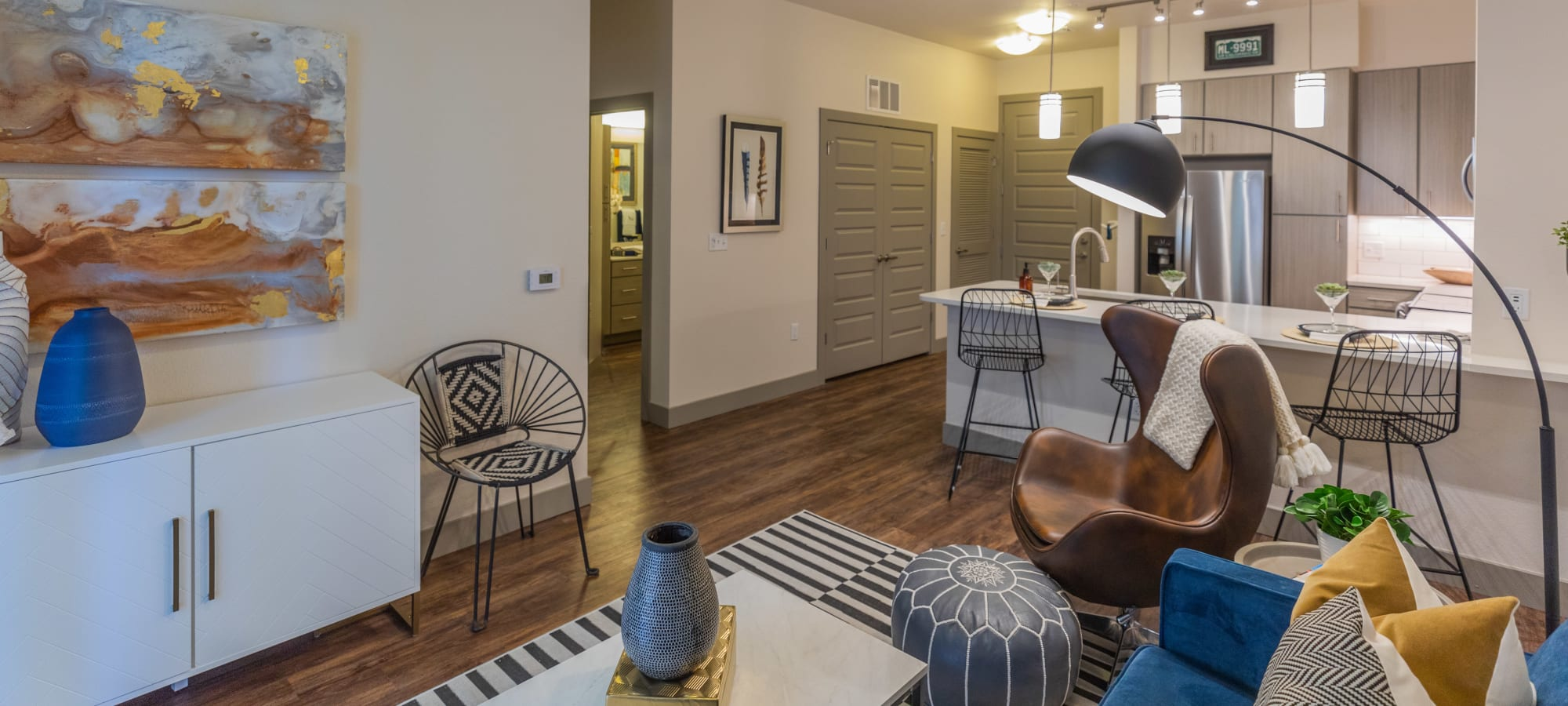 Classically furnished model home's living area at The Alcott in Denver, Colorado