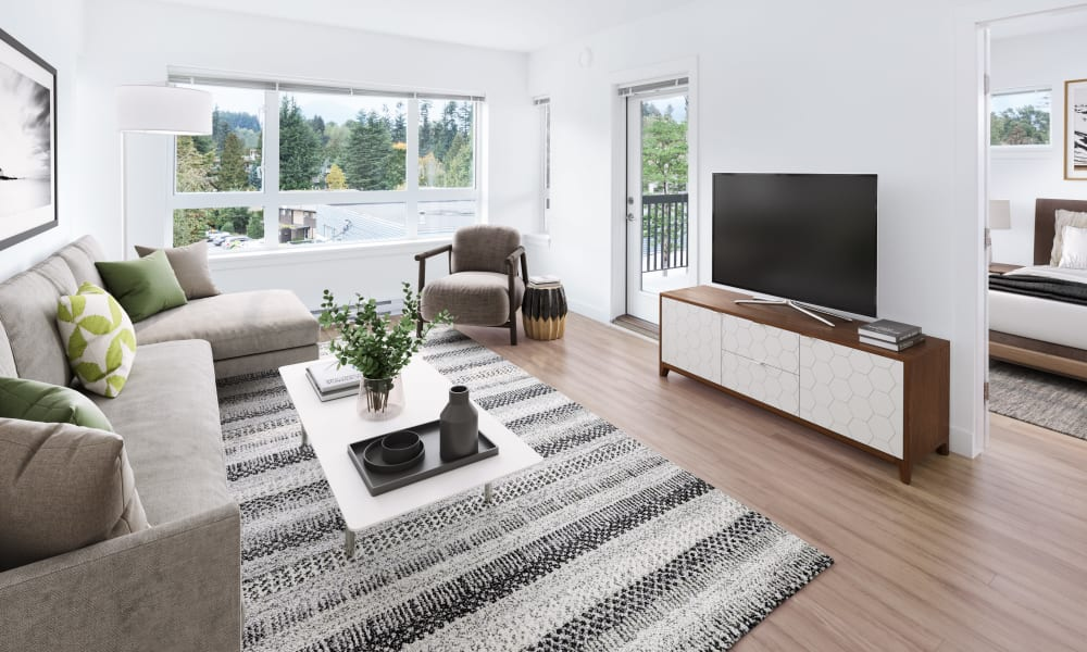 Model living room with hardwood floors at Northwoods Village in North Vancouver, British Columbia
