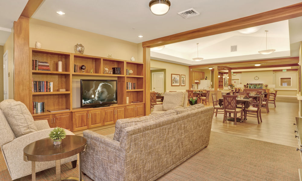 Common area with large couch at Seven Lakes Memory Care in Loveland, Colorado