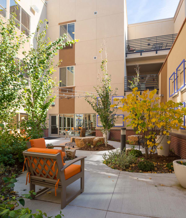 View of the courtyard at Village at Belmar with comfortable seating on a beautiful day