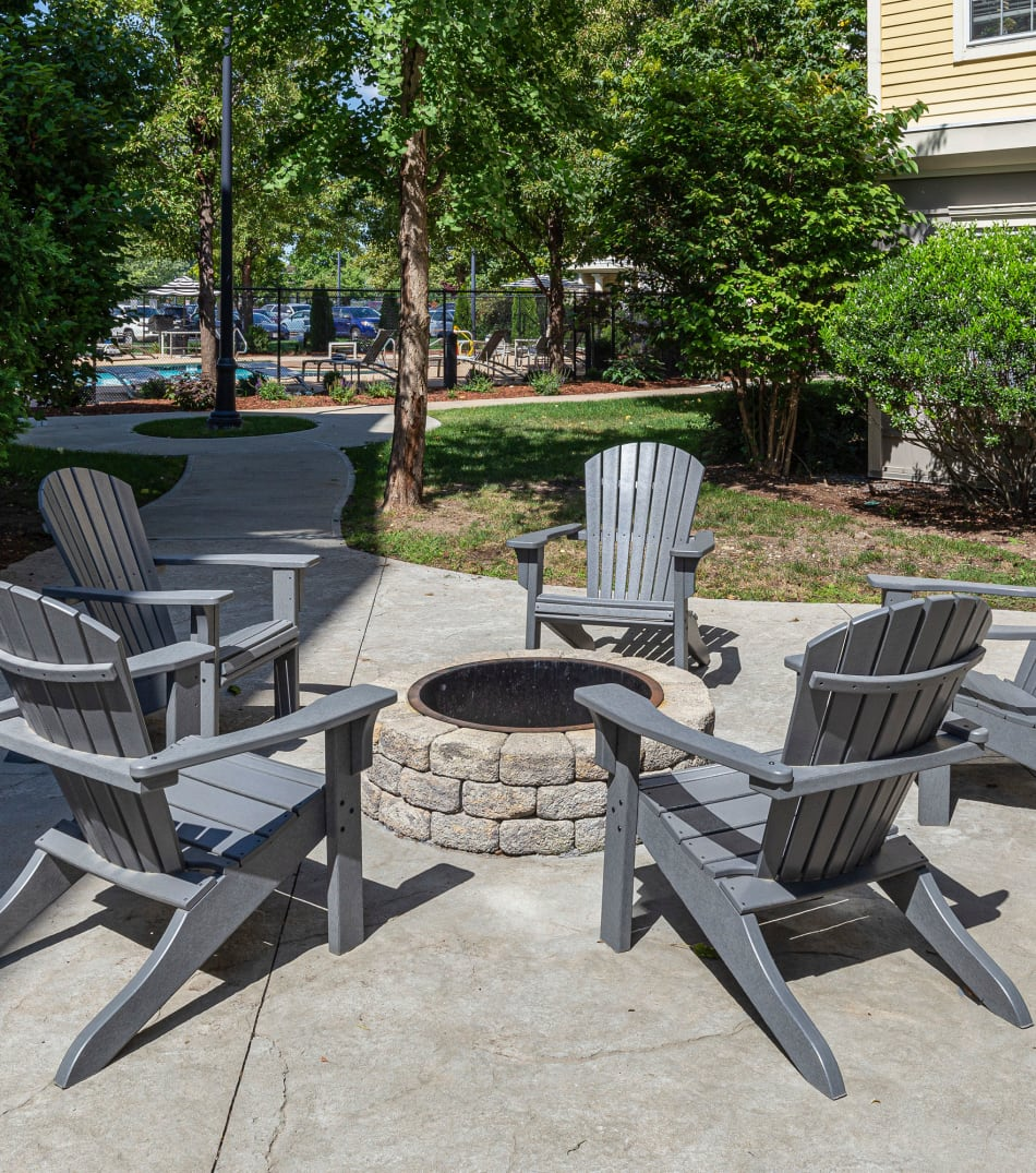Outdoor firepit area with chairs to sit in and enjoy at Sofi at Salem Station in Salem, Massachusetts
