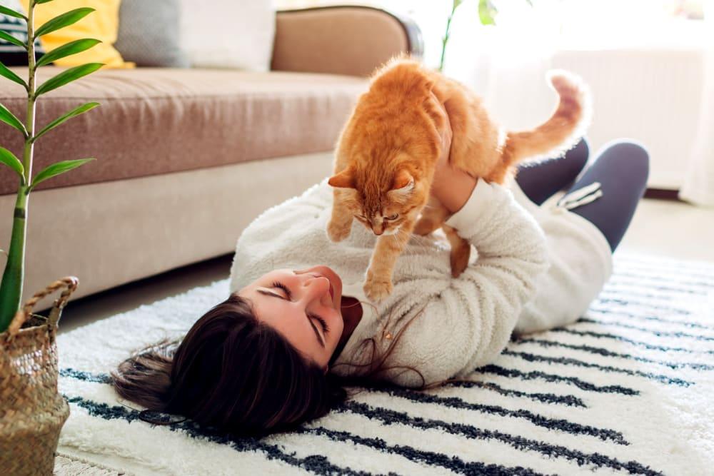 Resident loving on her cat at Lake Jonathan Flats in Chaska, Minnesota
