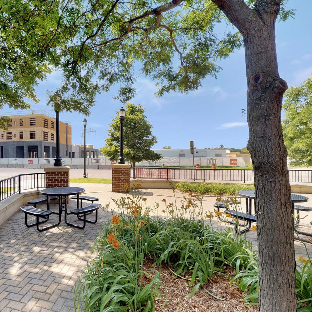 Park-like courtyard shaded by mature trees at Oaks Hiawatha Station in Minneapolis, Minnesota