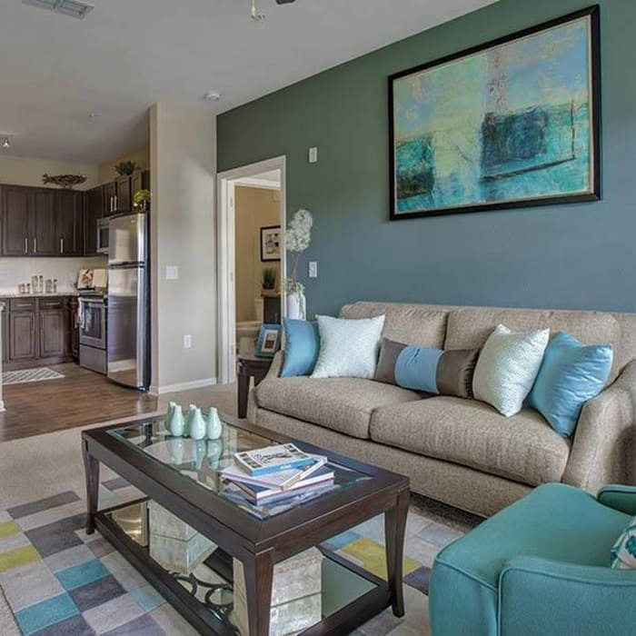 Luxury living room at Integra Hills Preserve Apartments in Ooltewah, TN