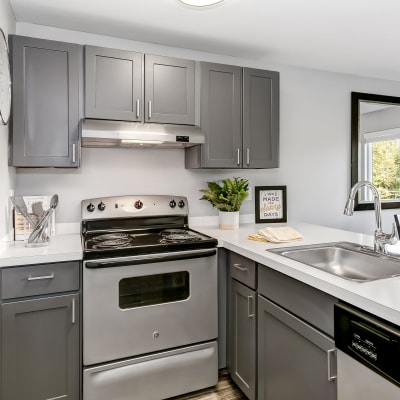 Modern kitchen with stainless-steel appliances in a model home at Sofi Lakeside in Everett, Washington