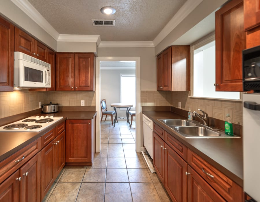 Large kitchen with dishwasher at 8500 Harwood Apartment Homes in North Richland Hills, Texas