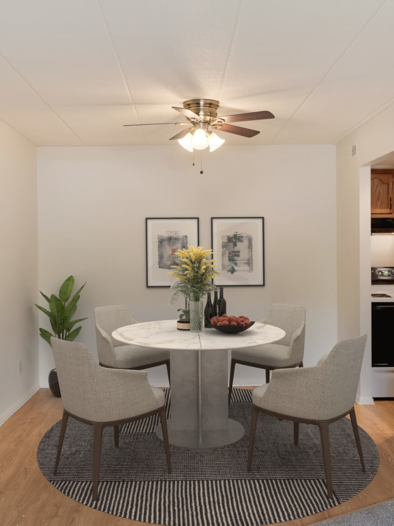 A dining room with a ceiling fan at Vantage Pointe West Apartments in Cincinnati, Ohio