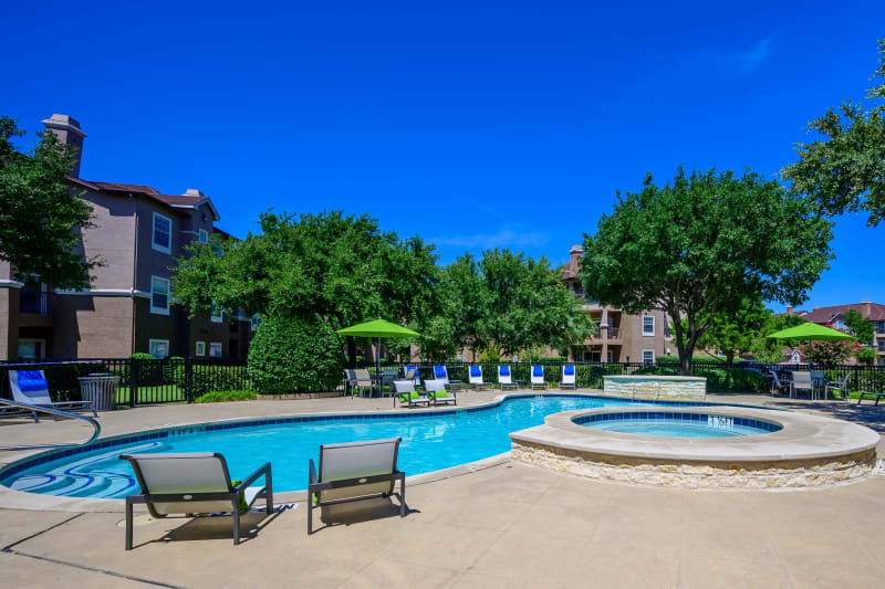 Resort style pool with lounge chairs at The View at Lakeside in Lewisville, Texas