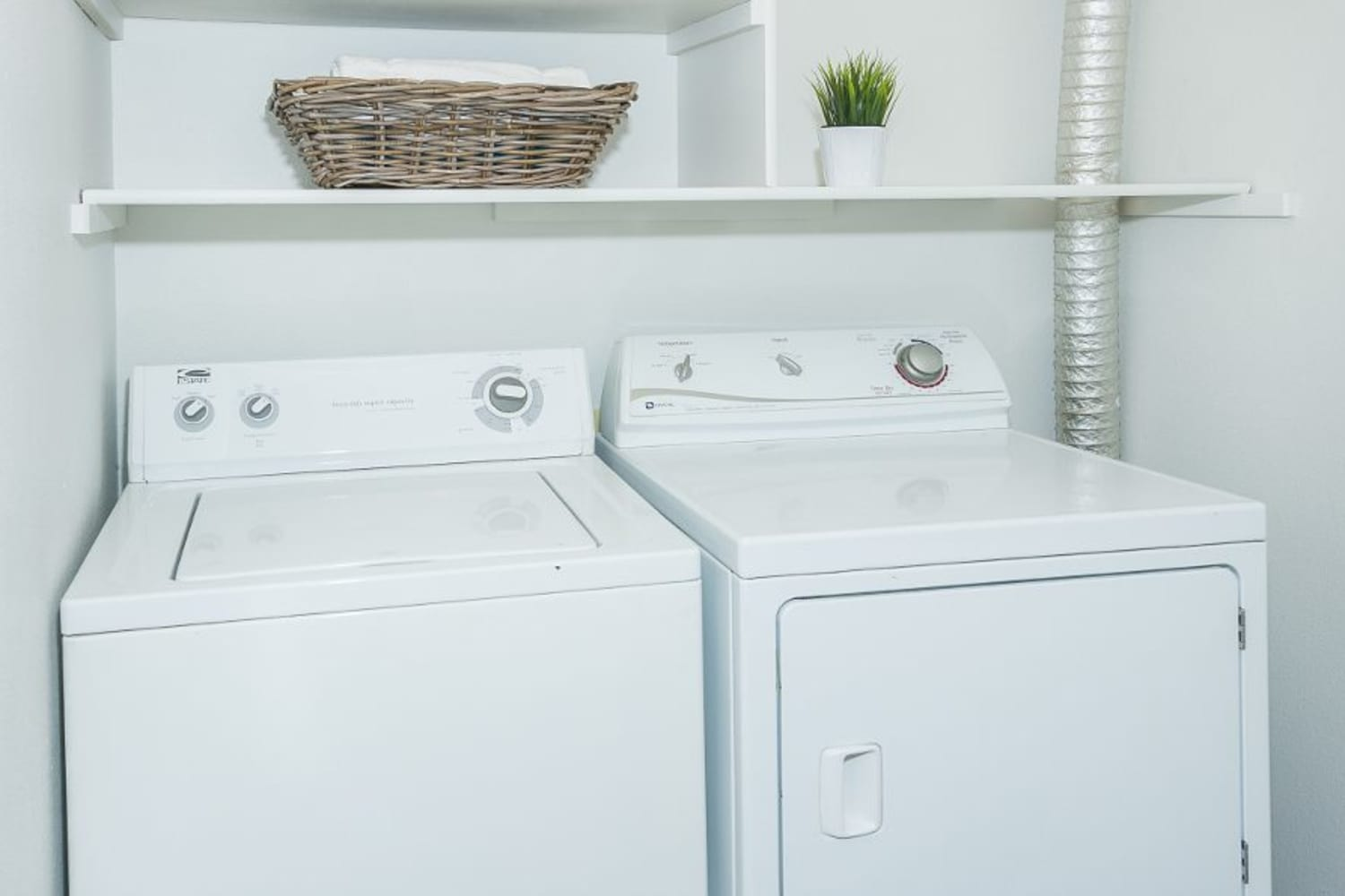 Washer and dryer in unit at Metropolitan Park Apartments in Seattle, Washington
