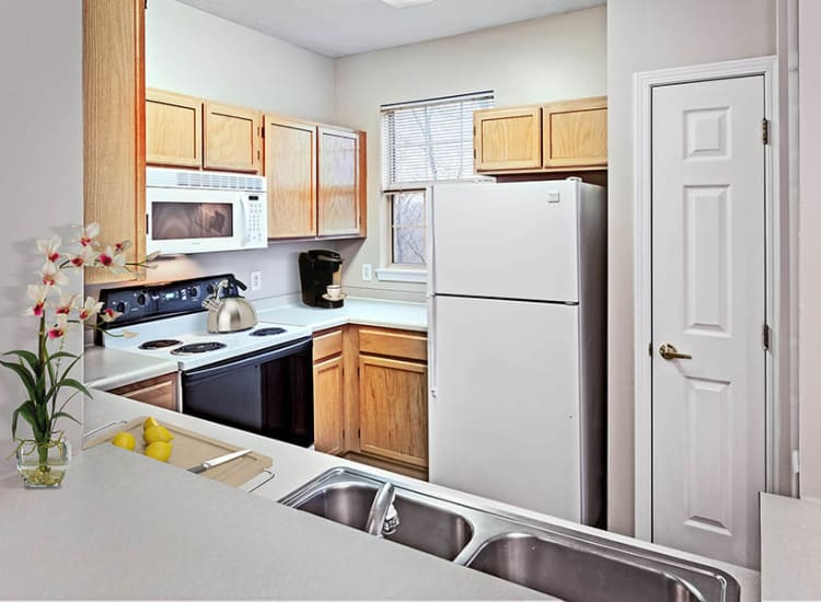 Cook your favorite meal in your kitchen at Highlands of Montour Run