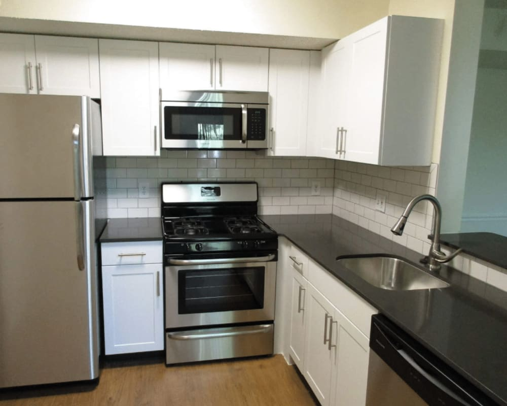 Modern kitchen appliances and cabinetry at Vista Point Apartments in Wappingers Falls, New York