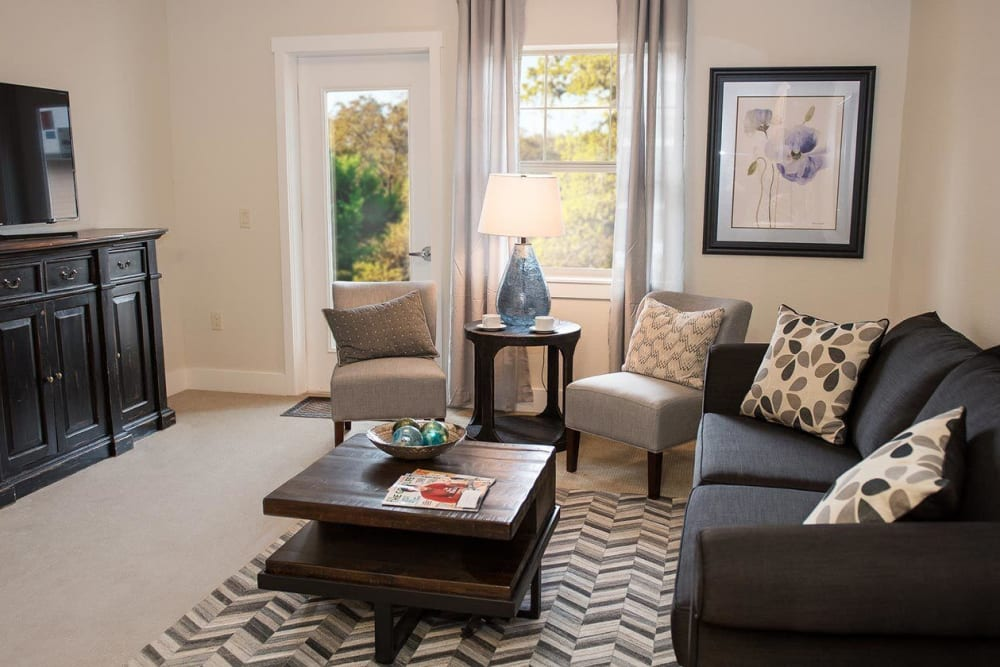 Luxurious living area at senior living apartment in The Springs at Greer Gardens at Eugene, Oregon