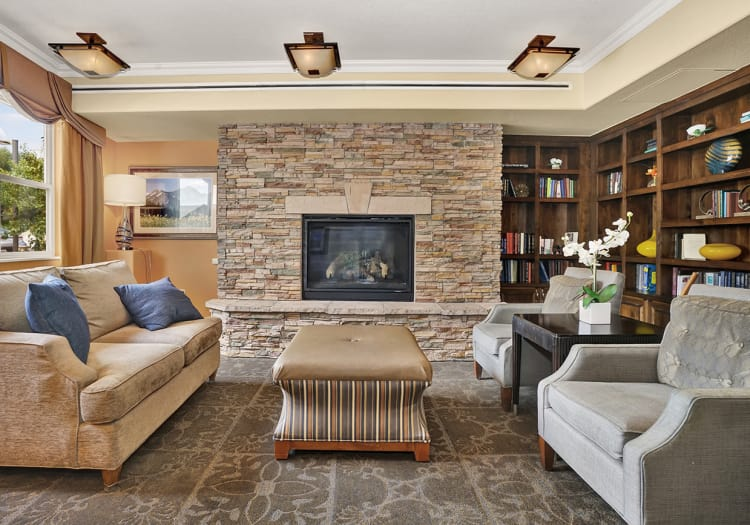 Lounging area in front of fire place at The Palisades at Broadmoor Park in Colorado Springs, Colorado